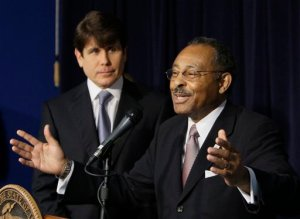 Gov. Rod Blagojevich and, right, Roland Burris.