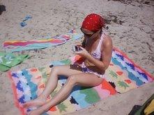 Alicia tanning