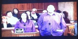 Couple wearing matching purple shirts.
